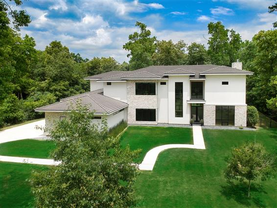 elevated photography of Kingwood, TX home with drone